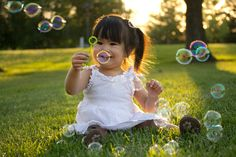 children, child, candid, bubbles, sun flare, photography, back lit, child photography, candid, 18 months, smiling, girl, toddler photography
