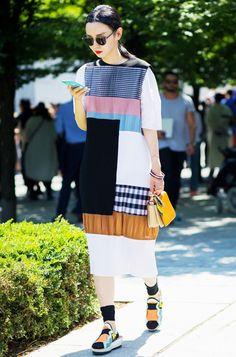 Sherry Shen wears a patchwork mixed print dress with bright accessories
