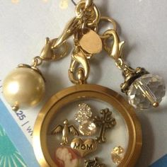 "Vintage gold. https://www.facebook.com/owlsurvive Origami Owl Living Lockets! Personalize yours today! ORDER BY CLICKING ON PHOTO 1) Click ""Sign in to My Account"" 2) Create Account 3) Happy Shopping! Designer #10657 JOIN MY TEAM! Host a party :-) Join the fun! happilynapoli@yahoo.com 330.618.6211"