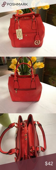 Beautiful Coral Handbag Beautiful Coral Handbag Great for Summer , roomy with center divider and pockets , zip closure. Bags Satchels