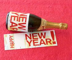 Welcome the new year with a bottle of champagne or wine wrapped up as a pretty present. Free Labels to Download (tons)