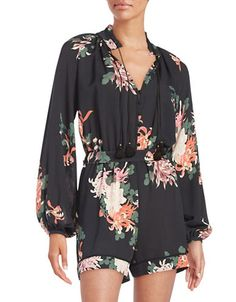 "A feminine, flirty romper with a high collar and colorful print Stand collar with tassel accents Button yoke Long sleeves with button cuffs Self-tie waist About 34"" from shoulder to hem"