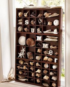 Printer tray redesigne with coastal decor and shells