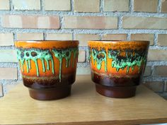 Pair of fat lava flower pots 1960s / 1970s orange spacey by Qvirky