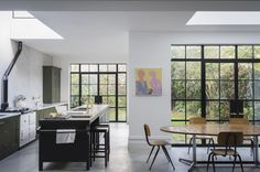 Kitchen with steel-framed windows: Plain-English Mapesbury Estate kitchen in London | Remodelista