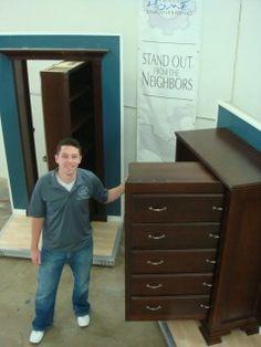 Panic room behind a dresser.