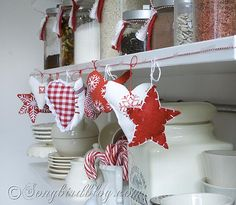 Decorate your kitchen for Xmas. Make these easy fabric ornaments and create a garland for your kitchen shelves. See more details at http://www.songbirdblog.com