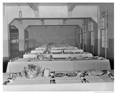 Alcatraz Prison inmate's dining room. Notice the tables set nicely, most likely for a holiday celebration.