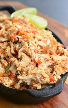 Juicy, tender, Salsa Chicken cooked in the crock pot with fresh salsa mixture. Amazing shredded chicken that's perfect to use for sandwiches and dinners.