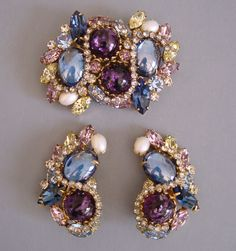 "CARNEGIE purple, and blue cabochons brooch and earrings with lavender, pale yellow, blue and clear rhinestones and artificial pearls, brooch 2-1/4"" earrings 1-3/4""."