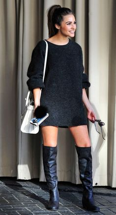 Olivia Culpo in a black sweater dress and over-the-knee boots - click ahead for more winter and Thanksgiving outfit ideas!