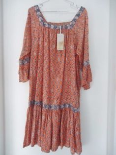 """Fabulous boho hippy East Anokhi Artisan dress 100% Cotton Handblock print Made in India Flounce detail to the sleeve and bottom of dress Earthy pinky orange background with multi colour floral pattern  Delicate silver tone embellishment Size 12  40"""" long from top of bodice to hem New with tags Price on label £69 Perfect dress for music festivals Beautiful cool frock for summer events, festivals, beach walking, honeymooning....."""