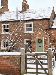 snowy brick house. Love the color of the door