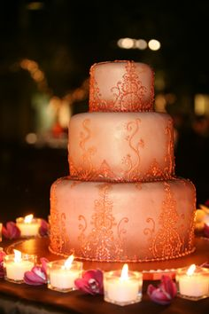 moroccan pattern wedding cake encircled by warm candlelight
