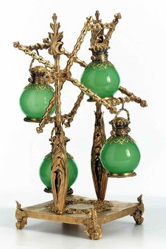 18th century French perfume windmill, made of gilt bronze, with fitted perfume bottles of opaque glass.