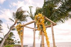 Bamboo tiki arch....but do flowers in another color
