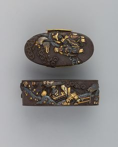 """Fuchigashira""  Japan.  18th century.  Iron and gold."