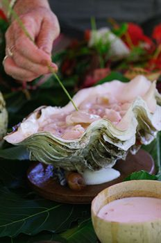 I love the idea of serving food in shells. For more Fiji Wedding inspiration please follow this board.