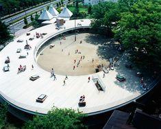 Montessori School Fuji Kindergarten - Tokyo, Japan;  designed by Tezuka Architects;  an oval kindergarten building with a roof deck;  photo by Katsuhisa Kida