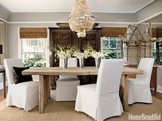 A Z Gallerie abalone chandelier in the dining room is a luminous foil for the elegantly distressed La Mer table from the Tobi Tobin Vintage Collection. Design: Tobi Tobin