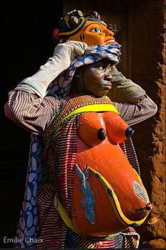 Africa | Dressed up like a woman (Adogono) for a ceremony held in honour of the fetisher « Guélédé ». ommune de Bagon Dovi-Cové, Henri Ahaouantchémè endosse le costume de femme enceinte (Adogono) pour une mascarade dansée Guélédé. Benin, Zou county, Bagon Dovi-Cové | ©Emilie Chaix