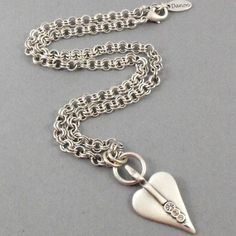 Sparkle this season when you wear the new Danon Silver Necklace with Swarovski Crystals Signature Heart Pendant on a double links silver plated chain.