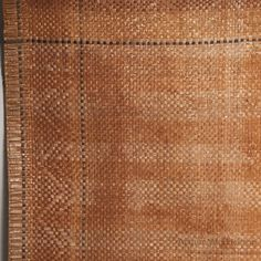 """L. 73""""; W. 39 1/2"""" A good intact Northwest Coast cedar bark mat. It has a thicker edge around the mat with a 3 3/4"""" border of somewhat darker cedar bark with a repeating """"V"""" design in it between two n"""
