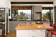 Homeowner Katy McCoy, an artist, did the shop drawings of the cabinetry for a Tom Kundig–designed Seattle home; her father, who owns a millwork and cabinetry firm, fabricated them.