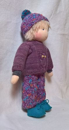 Een uiltje trui, gebreid van kabeltjes                     Het is koud buiten                    Hele dunne mohair haartjes