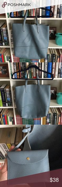 J. Crew Baby Blue Leather Tote Hi! This is an elegant and functional bag. Baby Blue Pebbled leather. Interior snap pouch. Some slight wear on bottom and bottom corners of bag. Originally purchased in the fall of 2014.  Help me clean out my closet! All reasonable offers considered!  Happy poshing! J. Crew Bags Totes
