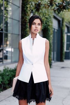 Evening outfit idea - fitted white vest & lace trim black mini skirt