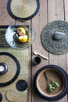 GR Essentials collection featuring Black trim and Tweed placemats,  black trim bread baskets and a mixed grass runner. The products are hand woven in Swaziland. #gonerural #woven #tableware