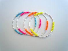 Set of 4 Bright Neon Swarovski Pearl and Metal Bracelets by HookedonArtsNCrafts via Etsy.