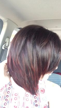 Dark brown to deep red ombre with short hair.