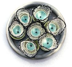 """""""Spin""""  ~ A unique brooch created by Karen Gilbert using sterling silver, cotton and enamel . Really just so unusual. http://karengilbert.com/work.html"""
