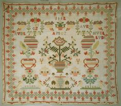 Though this is a Dutch sampler it has many motifs that are found on Welsh ones, though the whole sampler is more ordered. 1882 Large Antique Dutch Wool Work Sampler