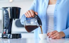 Woman using coffee maker for making and brewing coffee at home. Coffee blender and household kitchen appliances for makes hot drinks - Buy this stock photo and explore similar images at Adobe Stock Graphic Design Tutorials, Nespresso, Brewing, Coffee Maker, Household, Kitchen Appliances, Bon Appetit, Drinks, How To Make