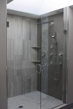 Space - Devices to Show Depth.  The foreshortened lines show this shower cubicle has depth.  Natural light, a neutral color scheme, and the vertical lines, help give this a more spacious feel.