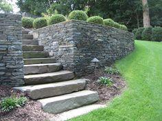 A natural stone retaining wall and steps   |   Island Hardscapes Ltd., Long Island, NY