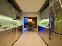 Modern kitchen designers can take a ton of worries about buying another kitchen by managing all parts of the design for your sake Galley Kitchen Design, Galley Kitchen Remodel, Modern Kitchen Design, Bookshelves In Living Room, Grey Cabinets, Kitchen Cabinets, Led Light Fixtures, Functional Kitchen, Diy Interior