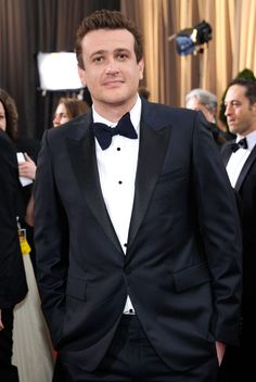 Funny man Jason Segel looks seriously handsome in this midnight navy classic tux