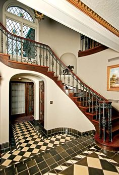 The entryway boasts a mammoth, sweeping staircase and Flint Faience tiles, once carpeted over. The owners chipped away tack-strip glue from the tiles a few inches at a time.
