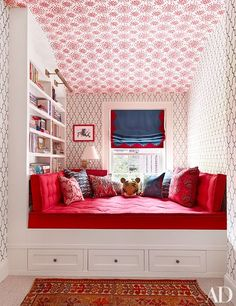 Wall coverings by Hinson & Co. (on the ceiling) and Phillip Jeffries (on the walls) animate a child's room; the picture light and swing-arm sconce are both from Circa Lighting.