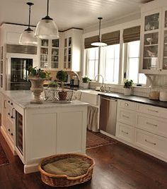 White cabinets, darks floors, oil rubbed bronze, and dark counter tops (maybe grey).
