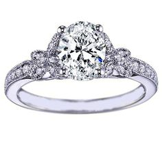 Oval Diamond Butterfly Engagement ring Pave band