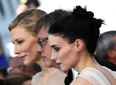 """Director Todd Haynes (C), cast members Rooney Mara (R) and Cate Blanchett pose on the red carpet as they arrive for the screening of the film """"Carol"""" May 17, 2015. REUTERS/Eric Gaillard"""