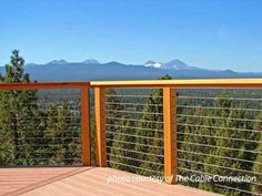 Steel Cable Railings On Porch Overlooking Mountain Range