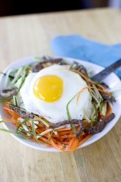Our Korean exchange student taught us how to make amazing bi bim bap, a healthy Asian recipe packed with protein and vegetables. From EatingRichly.com