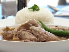 Ginataang manok.  Chicken cooked in coconut milk with grated ginger and chopped chilli. With a mildly-spicy bite, this is prepared to a Bicolano recipe.