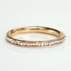 I would love if there was a wedding band with little pearls like this but in white gold. Pearl is my birth stone and I like its vintage  type look.